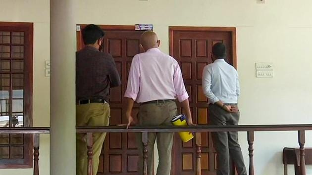 A three-member team of Customs officials at the residence of M Sivasankar (former principal secretary to the Chief Minister and IT secretary) to serve him a notice to appear for questioning in connection with the ongoing probe in the gold smuggling case.(ANI)