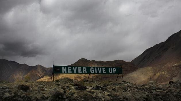 A banner erected by the Indian army stands near Pangong Tso lake near the India China border in India's Ladakh area.(AP)