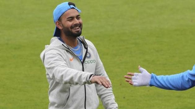 India's Rishabh Pant shares a light moment with a teammate during a training session/(AP)