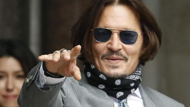 Actor Johnny Depp arrives at the High Court in London, Thursday.(AP)