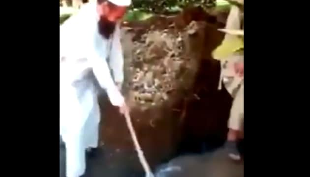 A video, which has since gone viral on social media, showed construction workers smashing the Buddha statue using a sledgehammer and expressing their resentment against the unIslamic relic.(Screengrab/ Aarif Aajakia @Twitter)