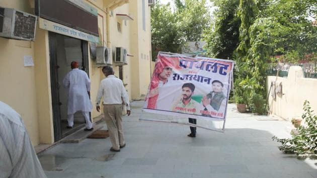 Banners of Congress leader Sachin Pilot are pulled down at State Congress Office after he was dropped from the Rajasthan's cabinet of ministers, in Jaipur, Rajasthan on Tuesday, July 14, 2020. (Photo by Himanshu Vyas/ Hindustan Times)