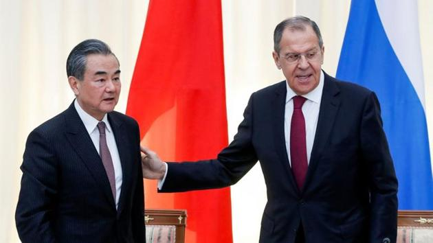 Russian Foreign Minister Sergey Lavrov and Chinese Foreign Minister Wang Yi.(REUTERS)