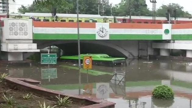 A DTC bus submerged in water under the Minot Bridge in New Delhi following heavy rain on Sunday morning.(ANI Photo)