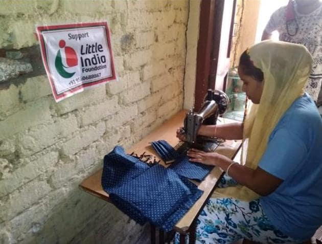 Women in some slum areas of Delhi are earning a livelihood by stitching masks with the help of an NGO.