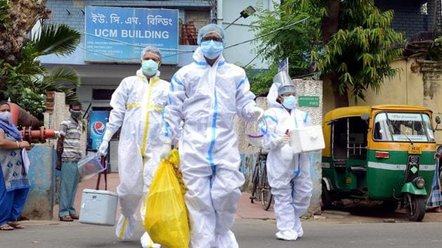 Health workers wearing PPE kit leave from SSKM Hospital to containment zones for collecting swab samples for the test of Covid-19, in Kolkata on Saturday.(ANI Photo)