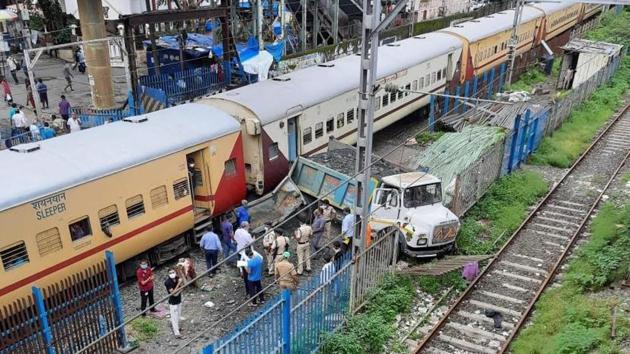 A truck climbed onto the railway tracks from a small opening near the Kandivali railway station and collided with the engine of an outstation train.(HT PHOTO.)