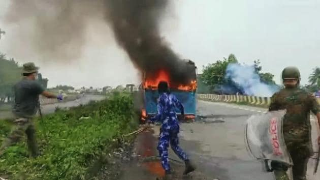 A bus that was set on fire on Sunday in Bengal's north Dinajpur district during clashes during a protest against an alleged rape and murder of a girl .(ANI)
