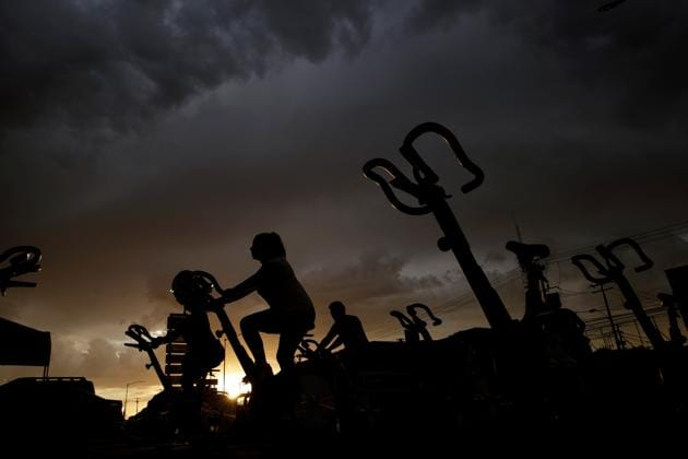 People exercise at the parking lot of a gym, where its fitness equipment was temporarily moved, as the government has not announced a reopening date for fitness centers, during the coronavirus disease (COVID-19) outbreak, in Ciudad Juarez, Mexico July 15, 2020. (Representational)(via REUTERS)
