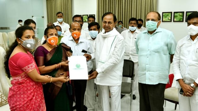 Telangana Chief Minister K Chandrashekhar Rao handing over the appointment letter to Santoshi in Hyderabad on Wednesday.(https://twitter.com/TelanganaCMO)