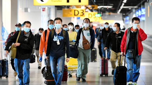 FILE PHOTO: People wearing protective face masks walk, as Schiphol Airport reduces its flights due to the coronavirus disease (COVID-19) outbreak, in Amsterdam, Netherlands April 2, 2020. (Representational)(REUTERS)