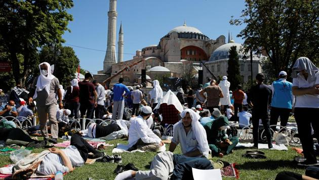 People wait for the beginning of Friday prayers outside Hagia Sophia Grand Mosque, for the first time after it was once again declared a mosque after 86 years in Istanbul, Turkey.(Reuters Photo)