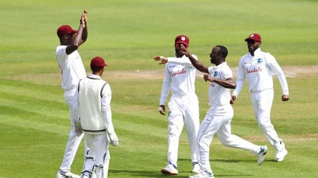 West Indies' Kemar Roach celebrates taking the wicket of England's Ben Stokes with Jason Holder and teammates, as play resumes behind closed doors following the outbreak of the coronavirus disease.(REUTERS)