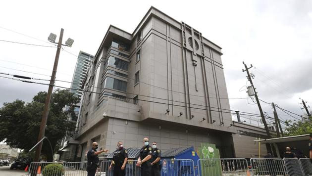 Police officers install barricades outside the Consulate General of China(AP Photo)