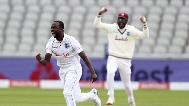 Manchester: West Indies' Kemar Roach, left, celebrates(AP)