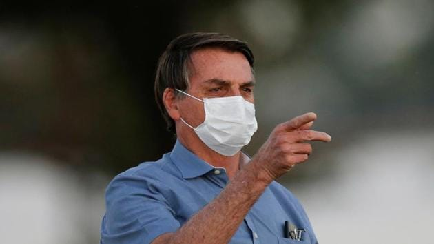 Brazil's President Jair Bolsonaro gestures before a ceremony of lowering the national flag for the night, amid the coronavirus disease outbreak, at the Alvorada Palace in Brasilia, Brazil.(REUTERS)