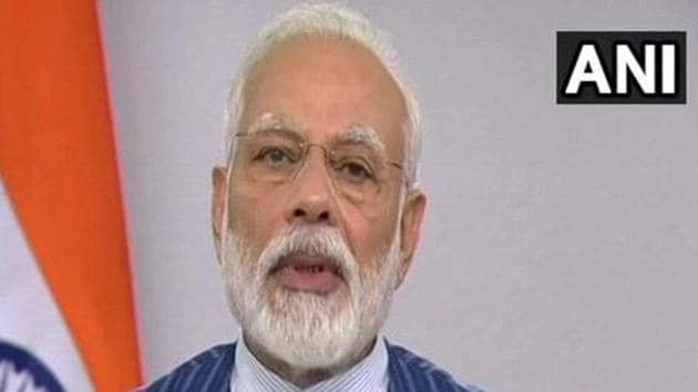 """Prime Minister Narendra Modi on Sunday reiterated the importance of wearing masks and social distancing and urged the country to fight the battle against coronavirus with """"full awareness and vigilance"""".(ANI PHOTO.)"""