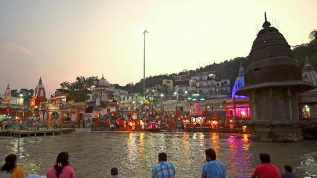 Devotees attend evening prayers at Har Ki Pauri ghat on the banks of the river Ganges, after the government eased a nationwide lockdown imposed as a preventive measure against the Covid-19 coronavirus at Haridwar in Uttarakhand.(AFP)