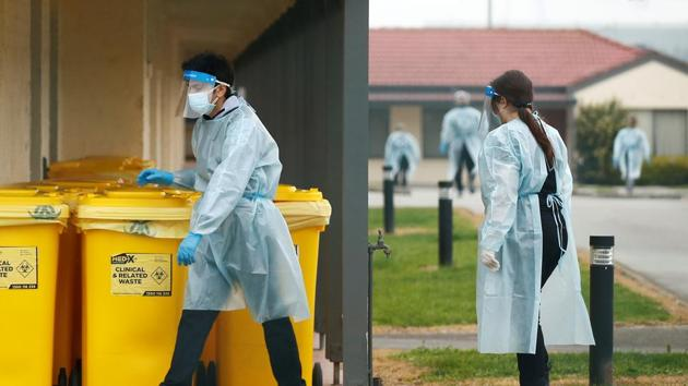Medical staff dispose of clinical waste at an aged care facility amid coronavirus disease outbreak in Melbourne, Australia.(REUTERS)