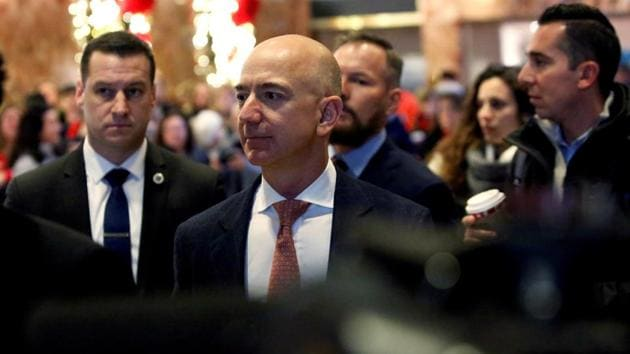 Jeff Bezos, founder, chairman, and chief executive officer of Amazon.com enters Trump Tower ahead of a meeting of technology leaders with President-elect Donald Trump in Manhattan, New York City, US.(REUTERS)