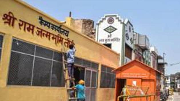 Workers paint an office near Ram Janmabhoomi in Ayodhya.(PTI File Photo)