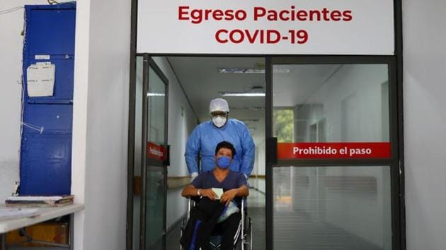 A patient who recovered from the coronavirus disease (Covid-19) leaving from the Juarez Hospital to go to his house in Mexico City Mexico on July 27, 2020.(Reuters Photo)