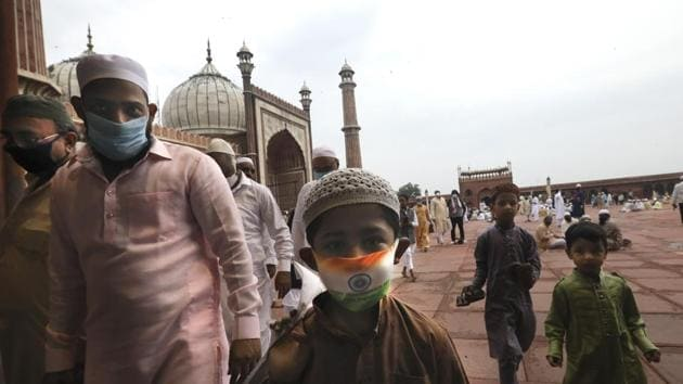 A boy wears a protective mask in the colors of the Indian national flag, leaves after offering Eid al-Adha prayer at the Jama Masjid in New Delhi.(AP)