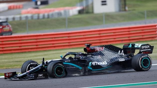 Mercedes' British driver Lewis Hamilton punctures near the finish of the Formula One British Grand Prix at the Silverstone motor racing circuit in Silverstone, central England on August 2, 2020. - Lewis Hamilton wins record seventh British Grand Prix . (Photo by ANDREW BOYERS / POOL / AFP)(AFP)