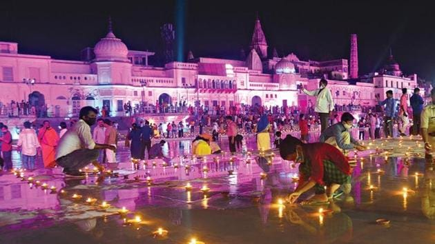 Ram Ki Paidi lit up by earthen lamps on the eve of the Ram temple foundation-laying function in Ayodhya on Tuesday.(Deepak Gupta/HT)