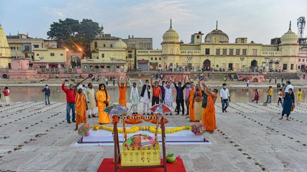 Large wooden slippers, bow and arrow, and palanquin put on display at Naya Ghat, on the eve of the groundbreaking ceremony of the Ram Mandir, in Ayodhya, on Tuesday.(PTI Photo)
