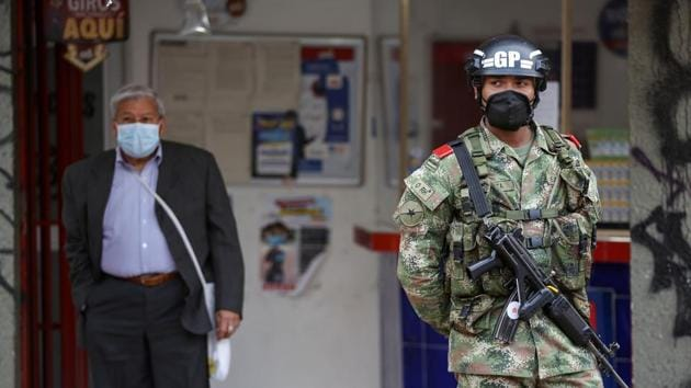 A military police officer wearing a face mask patrols a street during the government-mandated quarantine to lower the rates of contagion from the coronavirus disease outbreak, in Bogota, Colombia.(Reuters Photo)