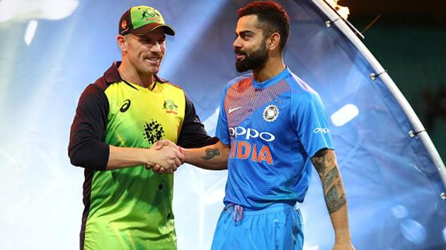 Rival international captains Aaron Finch and Virat Kohli will play together in the IPL.(Getty Images)