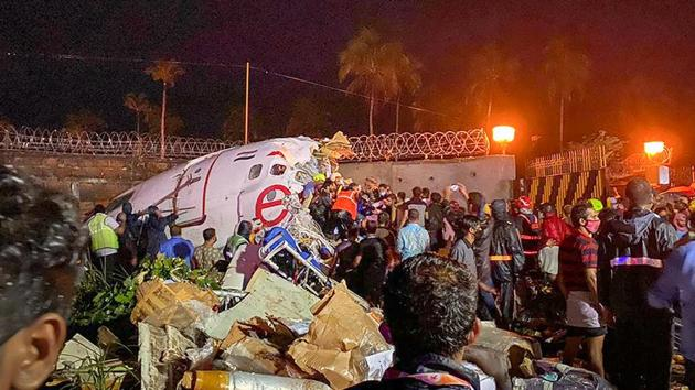 Rescue operations underway after an Air India Express flight with 190 passengers on board enroute from Dubai skidded off the runway while landing, at Karipur airport in Kozhikode on Friday.(PTI PHOTO.)