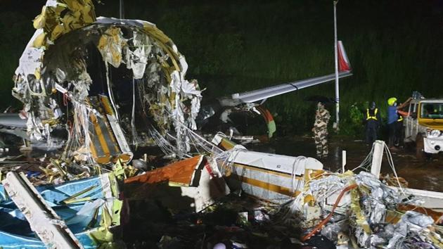 One half of the Air India repatriation flight lies among the debris in Kozhikode, Kerala.(HT Photos)