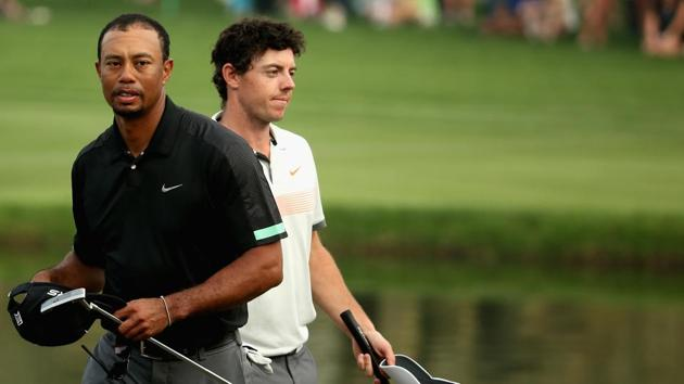Rory McIlroy and Tiger Woods walk off the 18th green during the second round of the 2014 Omega Dubai Desert Classic.(Getty Images)
