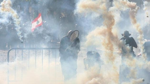 Riot police fire tear gas at demonstrators during a protest, following Tuesday's blast, in Beirut, Lebanon.(REUTERS)