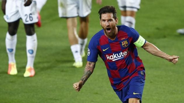 Lionel Messi celebrates after scoring his side's second goal during the Champions League round of 16.(AP)