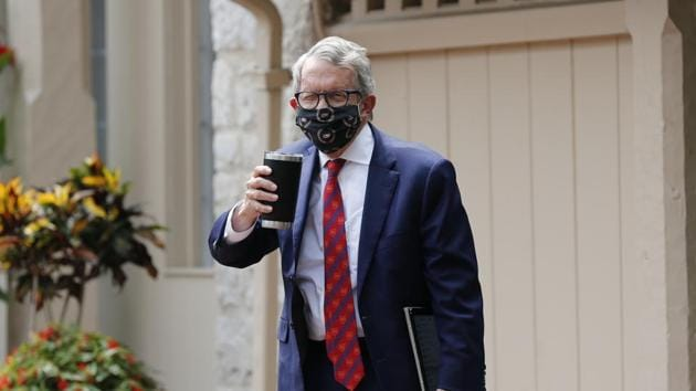 Ohio Governor Mike DeWine acknowledges members of the media while entering his residence after testing positive for COVID-19 earlier in the day Thursday, Aug. 6, 2020, in Bexley, Ohio.(AP)