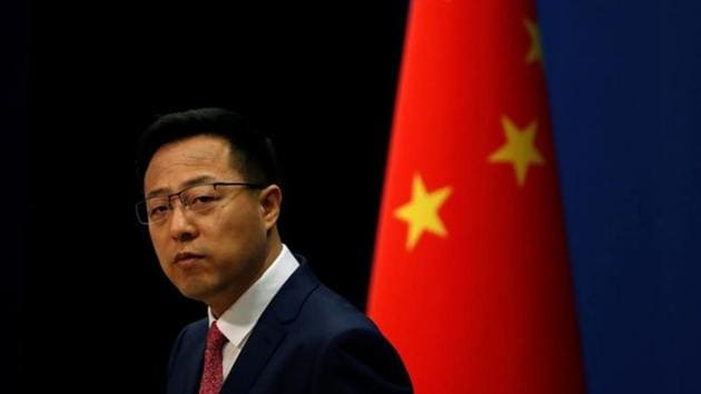 Chinese Foreign Ministry spokesman Zhao Lijian attends a news conference in Beijing, China.(REUTERS)