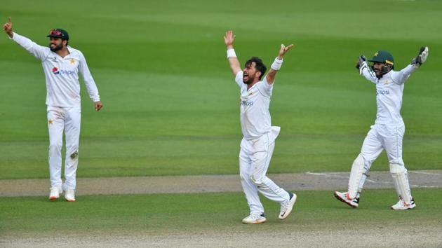 Cricket - First Test - England v Pakistan - Emirates Old Trafford, Manchester, Britain - August 8, 2020 Pakistan's Yasir Shah reacts, as play resumes behind closed doors following the outbreak of the coronavirus disease (COVID-19) Dan Mullan/Pool via REUTERS(REUTERS)