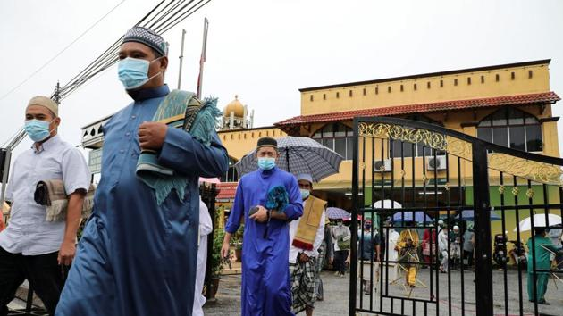 File photo of Malaysians wearing protective face masks leaving a mosque after Eid prayers, amid the Covid-19 outbreak in Kuala Lumpur, Malaysia.(REUTERS)