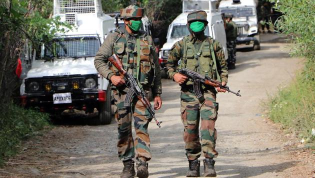 Army jawans at the encounter site in Amshipora area of Shopian on July 18. The army claims three unidentified militants were killed in the encounter.(ANI)