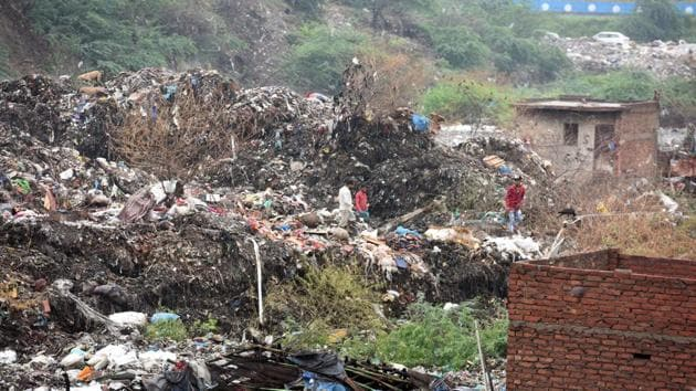 Ira Singhal, spokesperson of the North Delhi Municipal Corporation, said a small portion at the back of the landfill collapsed in the morning due to overnight rain.(Raj K Raj/HT PHOTO)