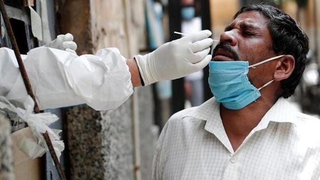 A health worker in personal protective equipment (PPE) collects a sample using a swab from a person at a local health centre to conduct tests for the coronavirus disease (COVID-19).(REUTERS)