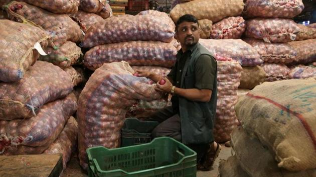 A man sorts onions at a vegetable wholesale market in Mumbai, India, February 14, 2019.(REUTERS)
