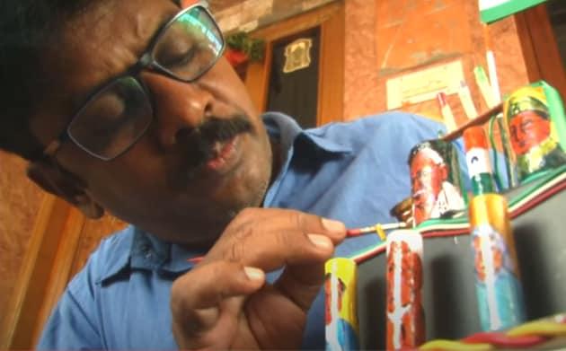 Coimbatore based miniature artist, Raja, draws images on cell batteries.(ANI)