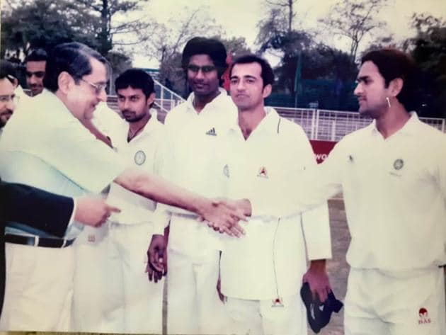 A young MS Dhoni being introduced to the then adviser. UT Chandigarh, Lalit Sharma, during the semi final of the Ranji Trophy Plate division against Haryana in March 2005