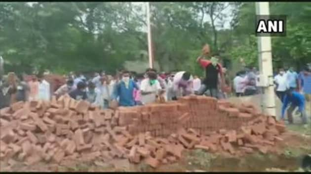 Locals in Bolpur in Bengal's Birbhum district vandalised construction material stocked by authorities to build a wall around the ground of the Visva Bharati university where an annual fair is held.(ANI)