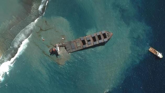 This satellite image provided by 2020 Maxar Technologies shows an aerial view on Saturday Aug. 15, 2020 of the MV Wakashio, a bulk carrier ship that recently ran aground off the southeast coast of Mauritius.(AP Photo)