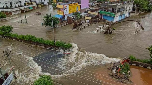 Flooded streets and submerged houses after heavy rainfall, in Warangal district on Sunday.(PTI)